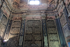 Picture of the wall covered with bones and skulls in an Ossuary Chapel of Milan